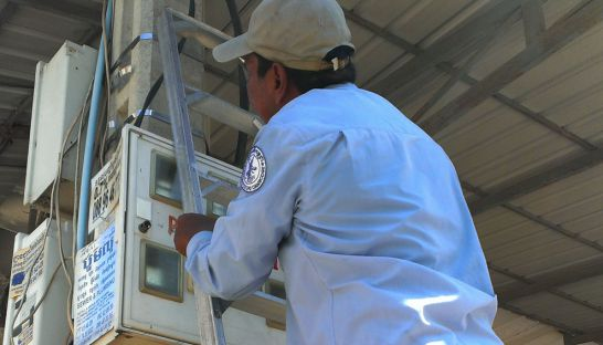 EdC staff was checking electricity meter in Phnm Penh.